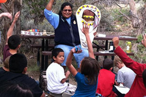 Students learning about Ute cultural artifact