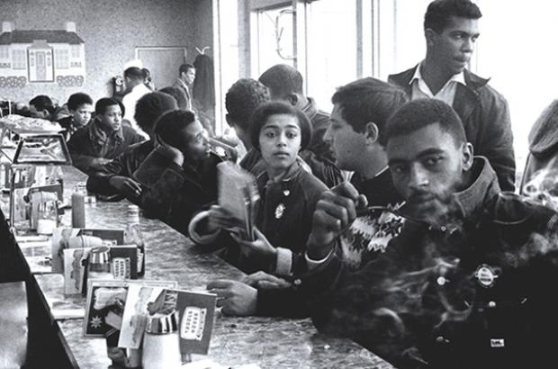 Judy Richardson (center, holding notebook) with other SNCC staff workers