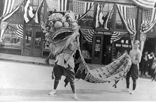 1921 Chinese lion dance in front of the East King Yick Building.