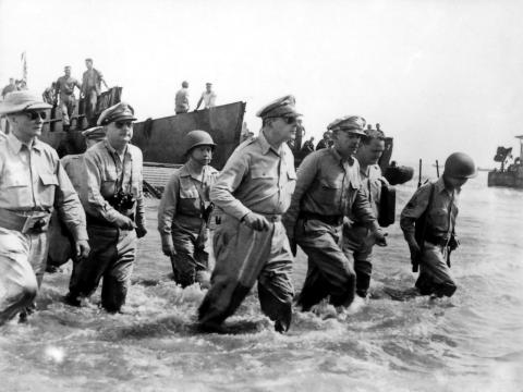 General Douglas MacArthur wades ashore during initial landings at Leyte, Philippine Islands (1944).