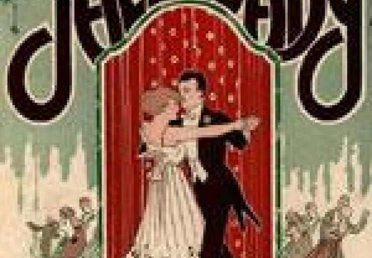 "Poster of a couple dancing, the woman in a long white dress and the man in a tuxedo, with the words ""Jazz Baby"" written over their heads in bold black lettering"