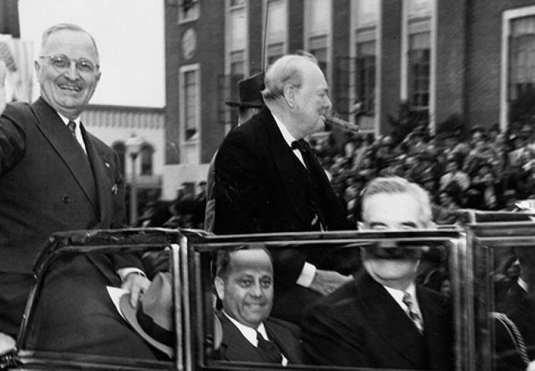 Truman waves from convertible as Churchill sits next to him smoking a cigar