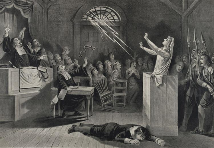A bolt of lightning releases the handcuffs on a woman accused of being a witch and strikes down her inquisitor in this late nineteenth-century lithograph of a colonial-era trial.