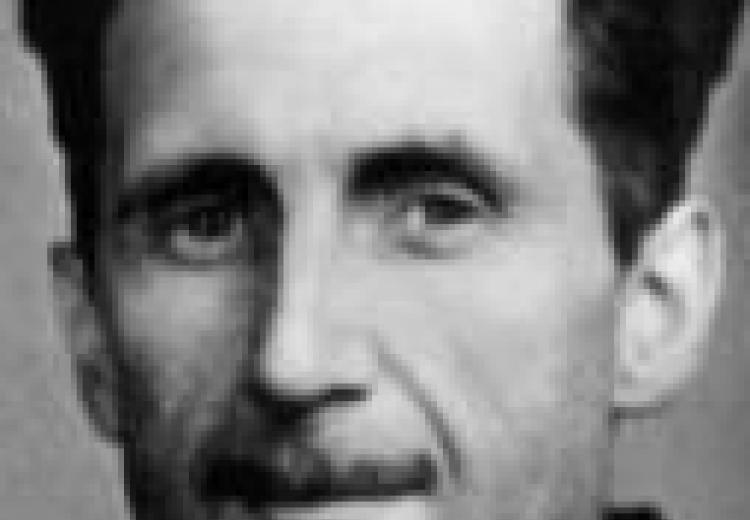 close up photograph of orwell's face; smiling slightly