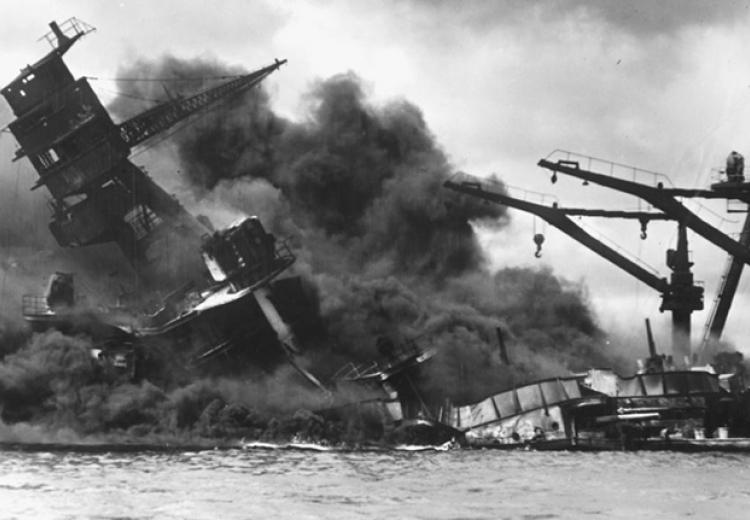 The battleship USS Arizona sinks after being hit by a Japanese air attack on Pearl Harbor