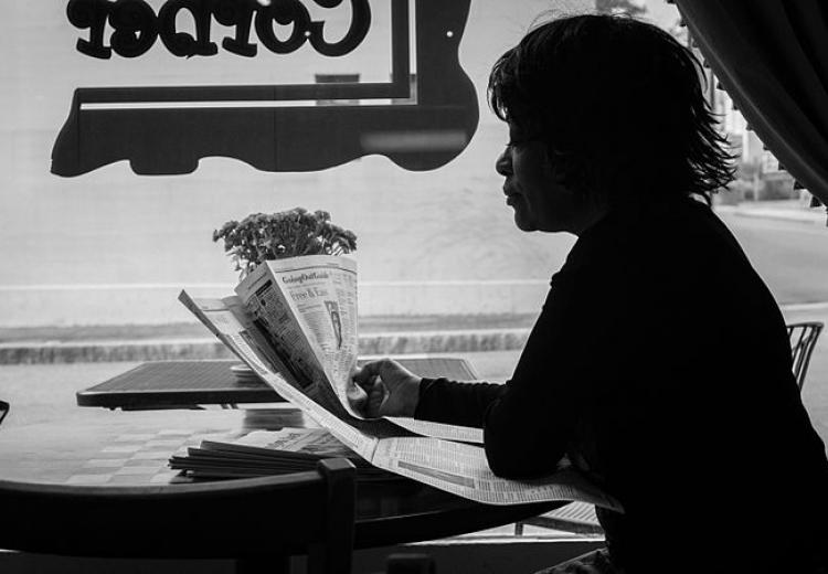 Photo of Rita Dove sitting by a window in 2013.