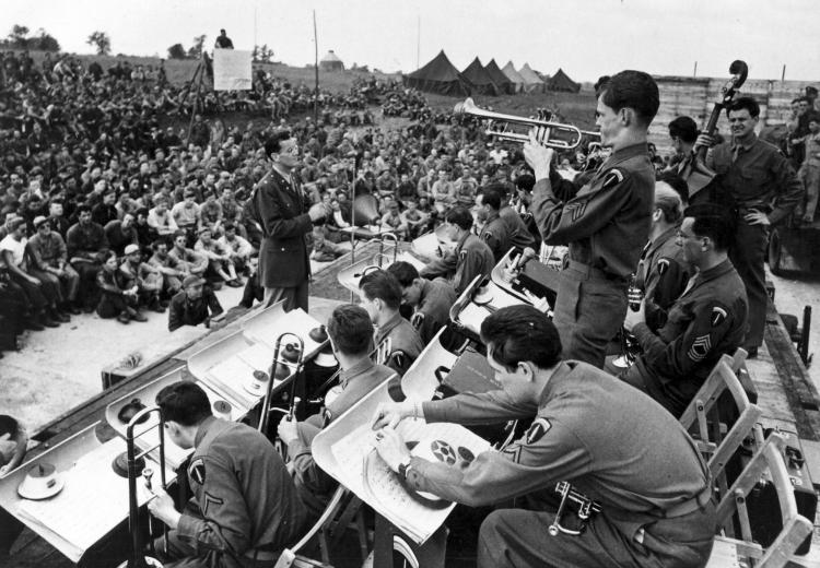 Maj. Glenn Miller conducts the band during an open air concert.