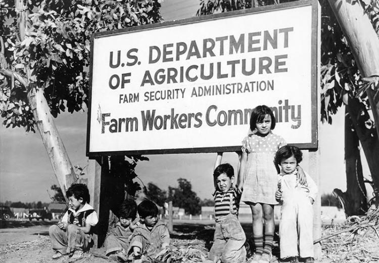 Group of children at front gate of FSA Camp, El Rio, California, 1941.