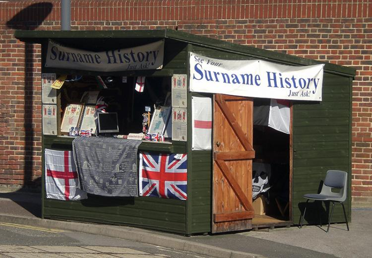 A stand at Portsmouth Historic Dockyard offering information on surname history.