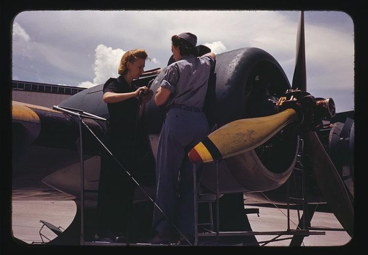 Bowen, a riveter, and Olsen, her supervisor, in the Assembly and Repair Dept. at the Naval Air Base in Corpus Christi, Texas (August, 1942).