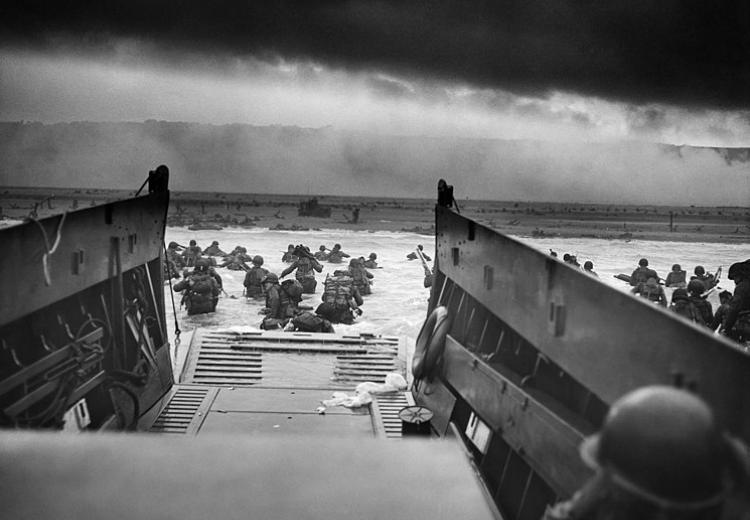 U.S. Troops wading through water and Nazi gunfire during the D-day landing on June 6, 1944.