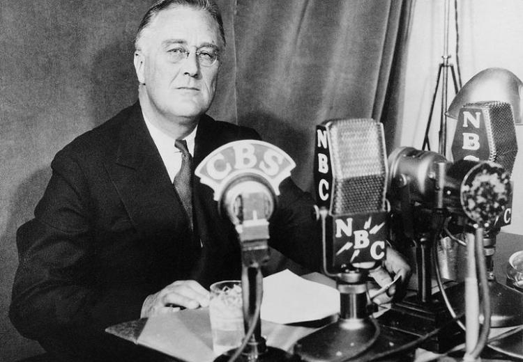 Photograph of Franklin D. Roosevelt at the White House in Washington, D.C., delivering a national radio address on September 30, 1934.
