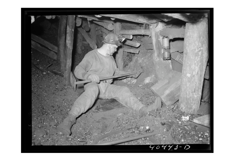 Joe Gladski, a coal miner at Maple Hill mine in Shenandoah (Schuylkill County, PA), sets dynamite in a mine shaft in 1938. Photograph by Sheldon Dick of the Farm Security Administration.