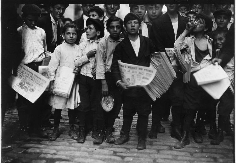 Newsboys and newsgirl in New York City getting afternoon papers (July, 1910).