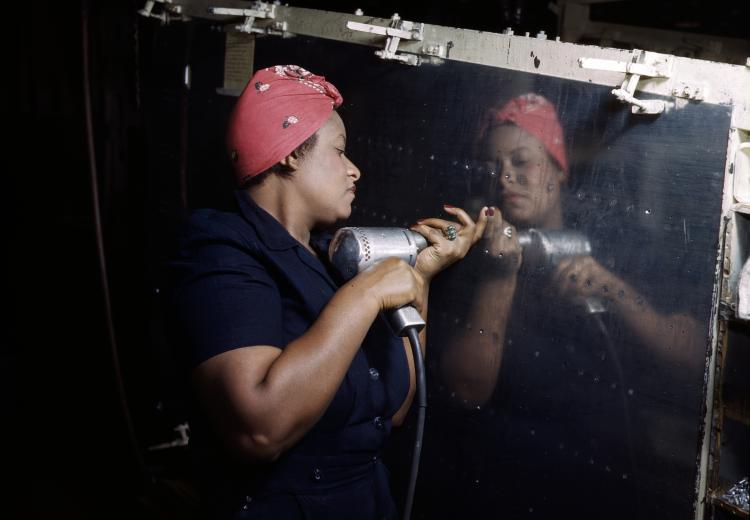 """Rosie the Riveter"" working on an A-31 ""Vengeance"" dive bomber in 1943."