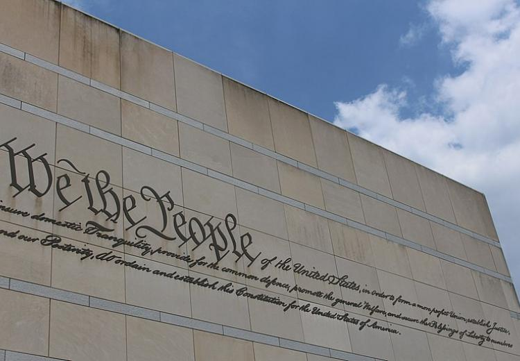 """We the People"" inscription located on the facade of the National Constitution Center in Philadelphia, PA."