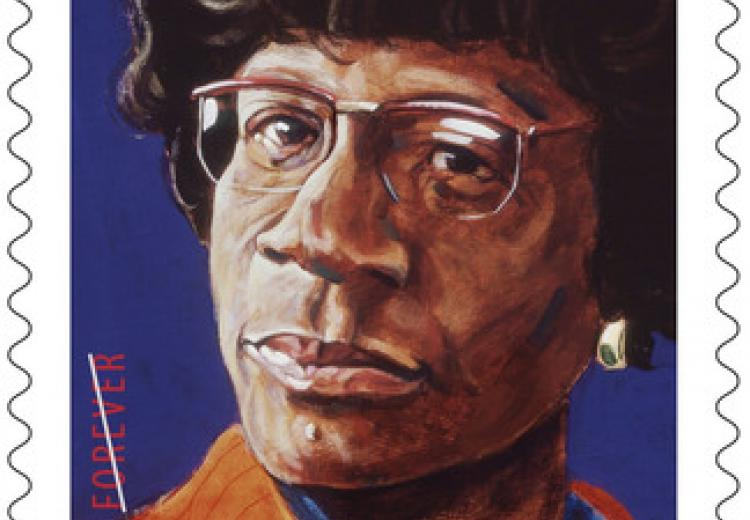 United States Postal Service commemorative stamp of Shirley Chisholm, issued in 2014.