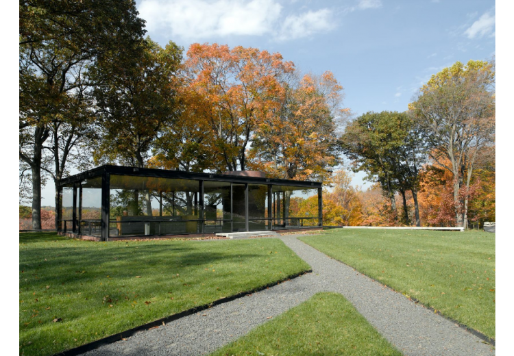 A photograph of Johnson's Glass House in the fall.