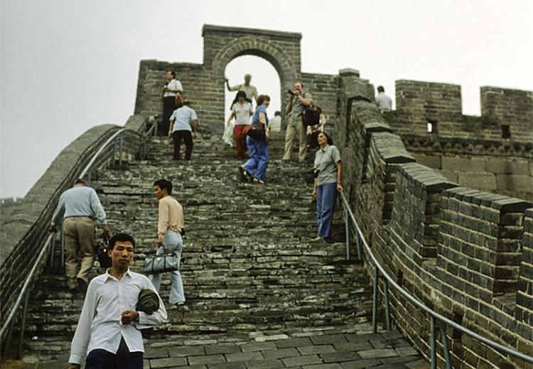 Sightseers walking on a section of the Great Wall of China
