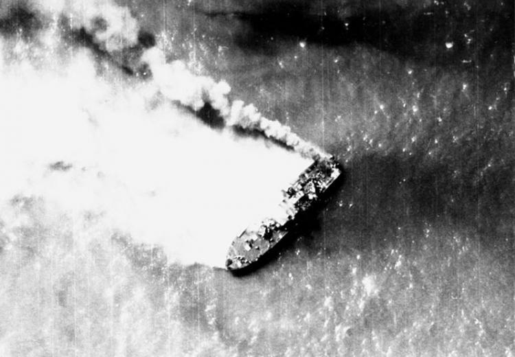 A North Vietnamese Shantou-class gunboat burns near Hon Ne Island