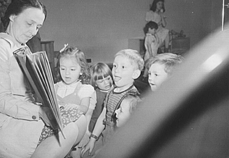World War II-era (1943) Buffalo, New York nursery school children react to Mother Goose during morning play period.