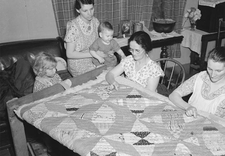 A quilting party in an Alvin, Wisconsin home.