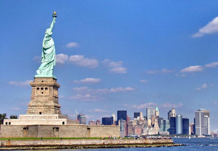 The Statue of Liberty against the Manhattan skyline.