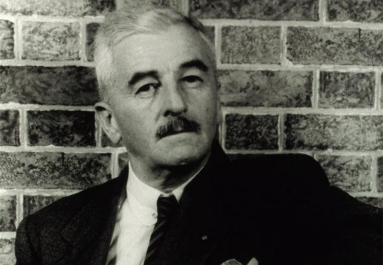 Photograph of author William Faulkner taken by Carl Van Vechten in 1954.